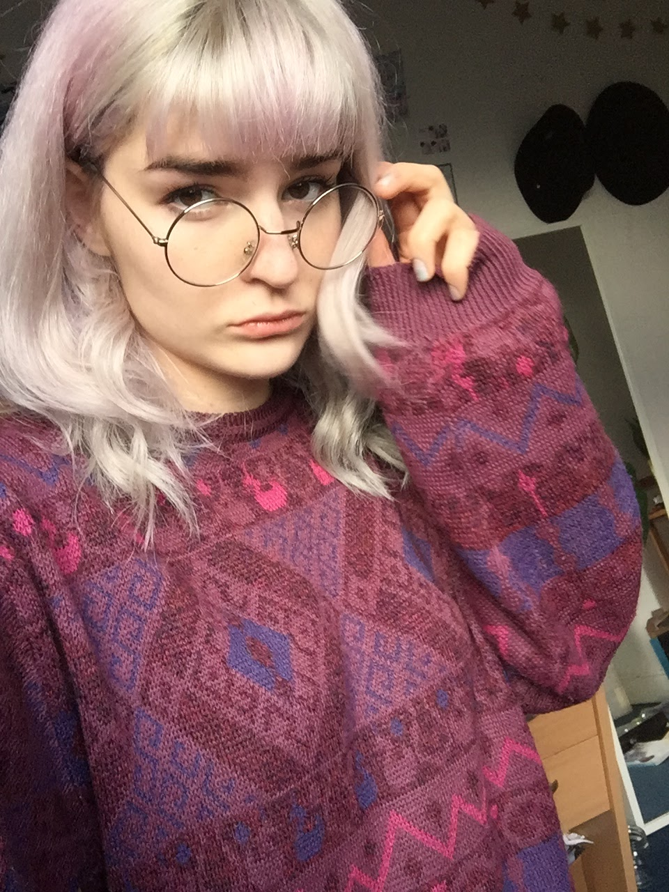 lavender haired girl in vintage jumper and round glasses