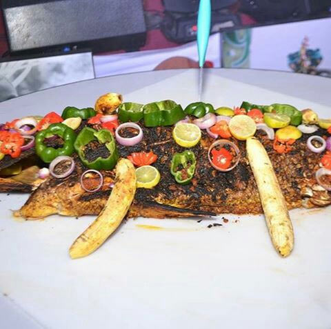 Sam Dede uses huge fish as birthday cake