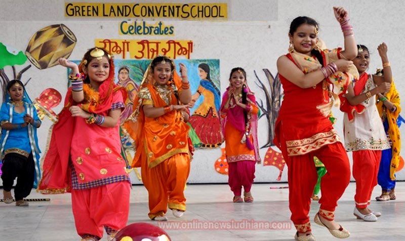 Students perform on stage during Teej Celebrations at Green Land Convent School
