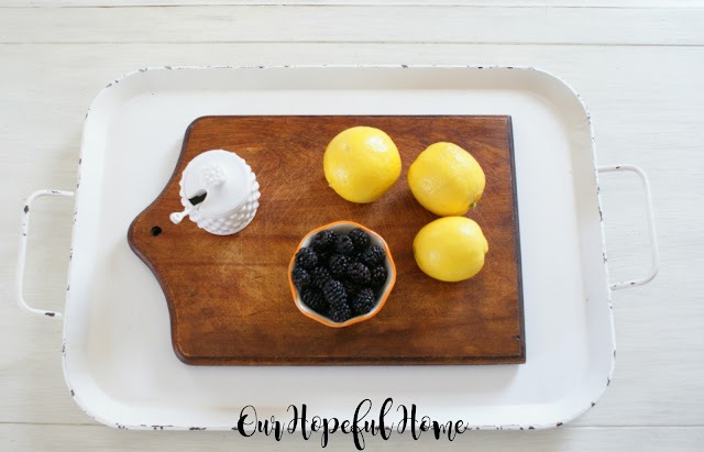aerial view cutting board lemons blackberries
