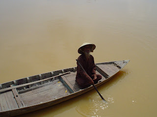 Fisherman in boat. Hoi An, Vietnam