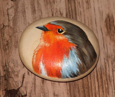 Another painted wooden pebble