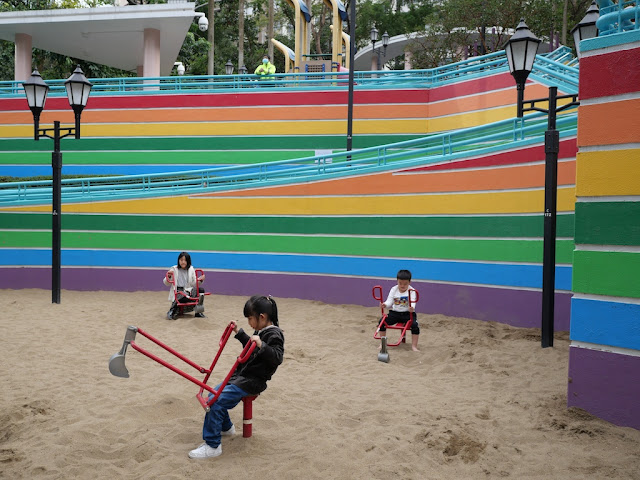 Children playing with sand scoopers at Hong Kong Park