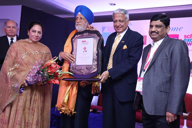 CTU Chancellor Chanranjit S Channi along with Parminder Kaur Channi while receiving the lifetime achivement award