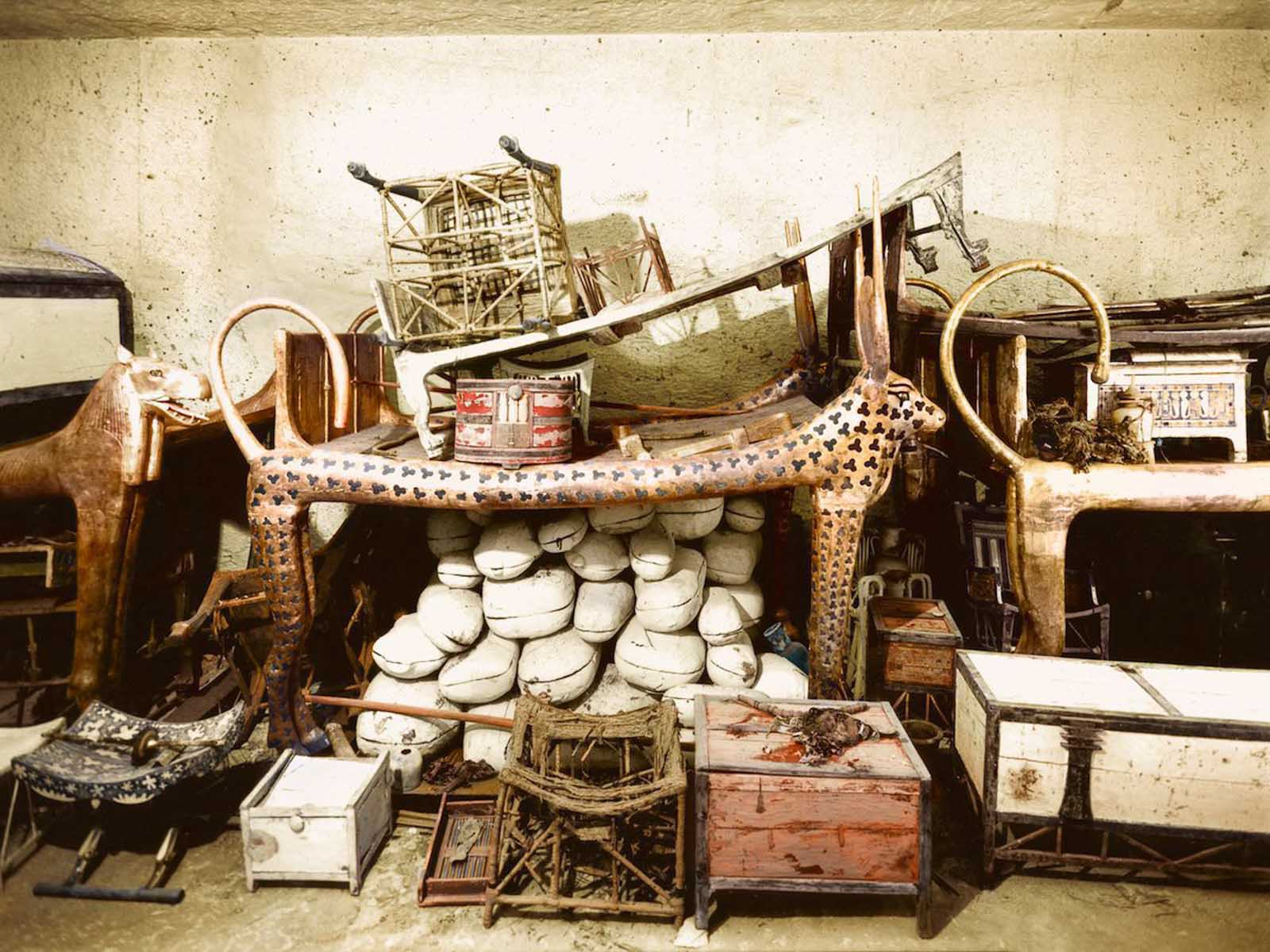 A ceremonial bed in the shape of the Celestial Cow, surrounded by provisions and other objects in the antechamber of the tomb.