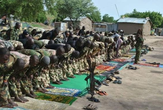 Photos: Soldiers with their guns on standby observe their Eid prayers