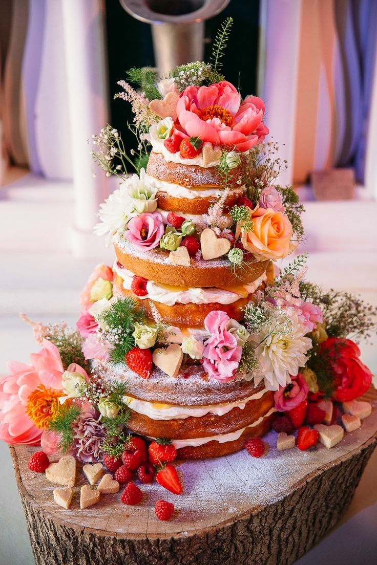 naked wedding cake with fresh flowers