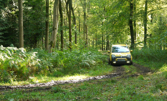 Fiat Panda Cross on a muddy green lane