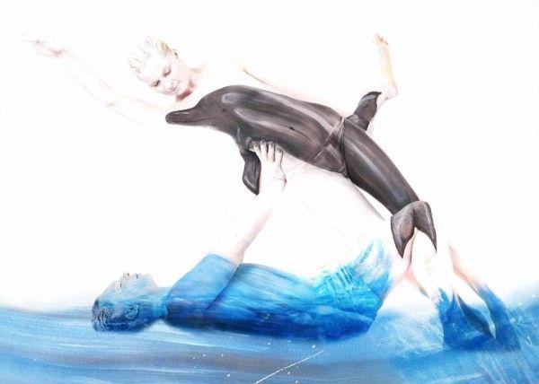 Body paint inusual y muy atractivo una pareja mar y delfin