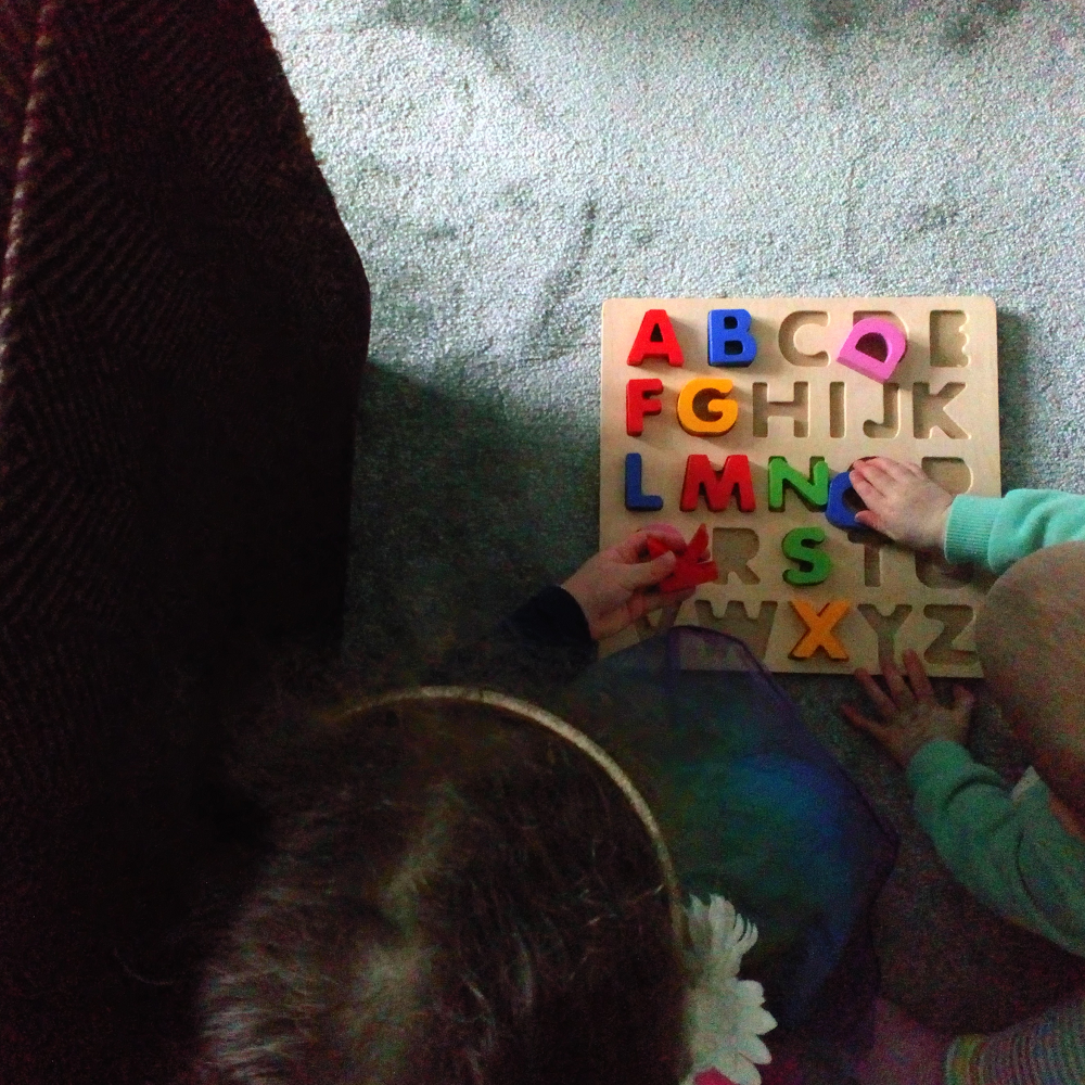Two kids doing a puzzle