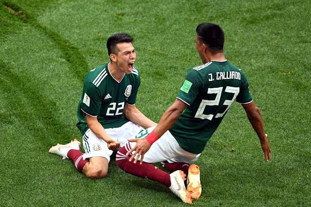 Hirving Lozano and Jesus Gallardo rejoice after Lozano's goal gave Mexico a 1-0 lead over Germany