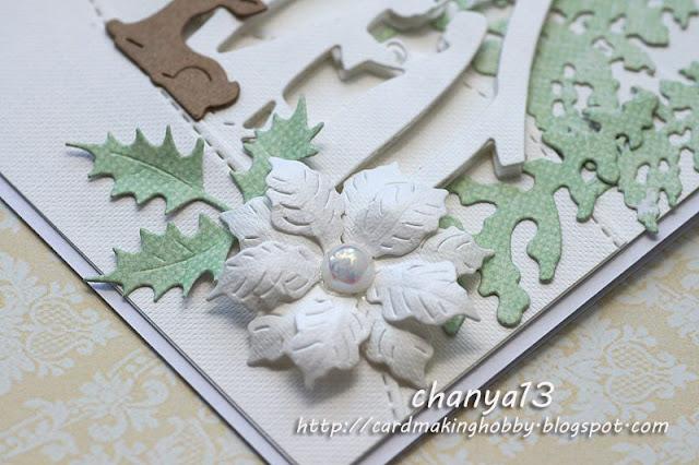 kartka świąteczna ozdobiona kwiatem z perłą