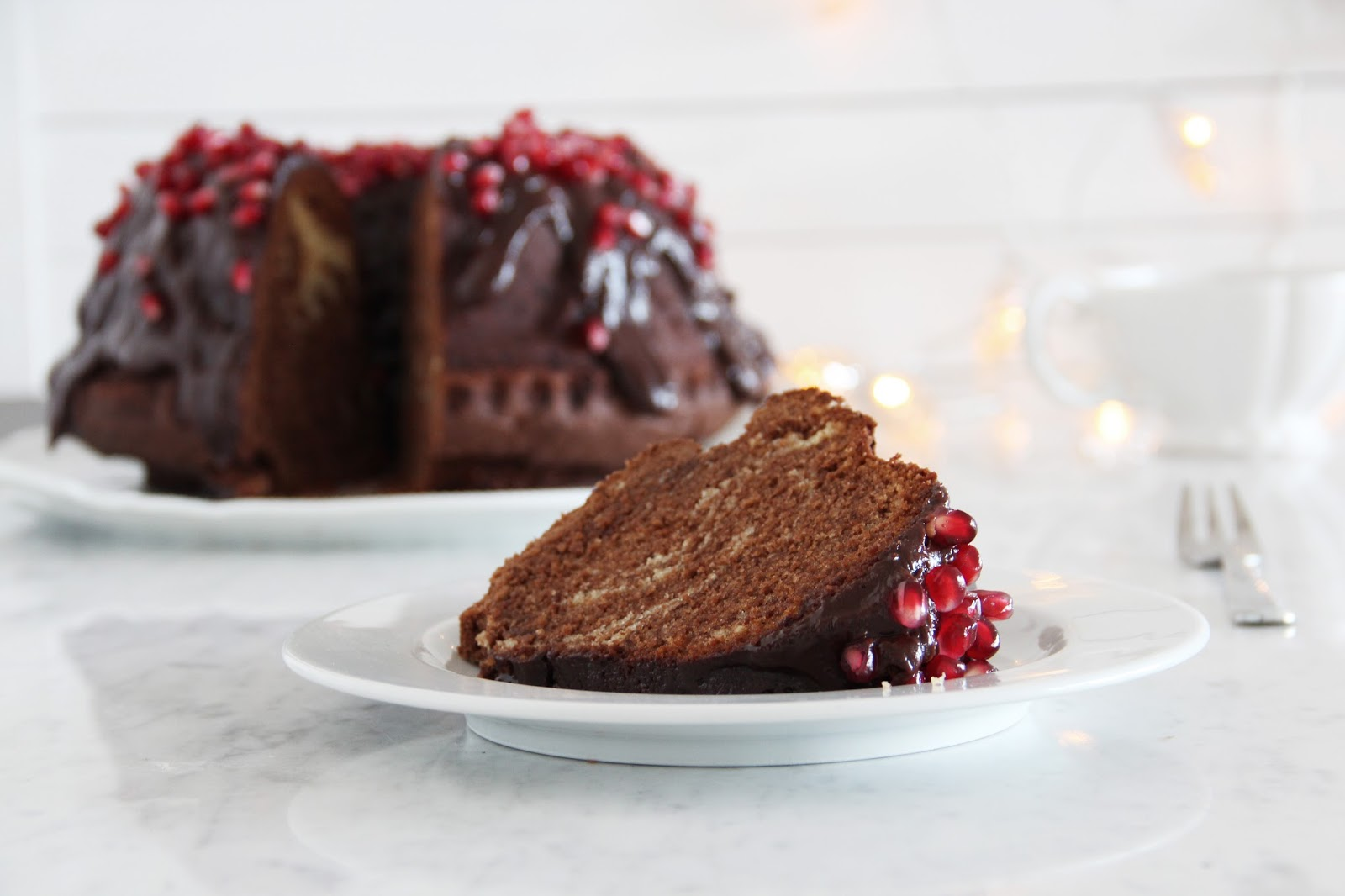 Lindt Chocolate Bundt Cake With Ganache Frosting Pomegranate Fork And Flower