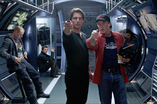 Director Brad Bird Tom Cruise on the set of Mission Impossible - Ghost Protocol