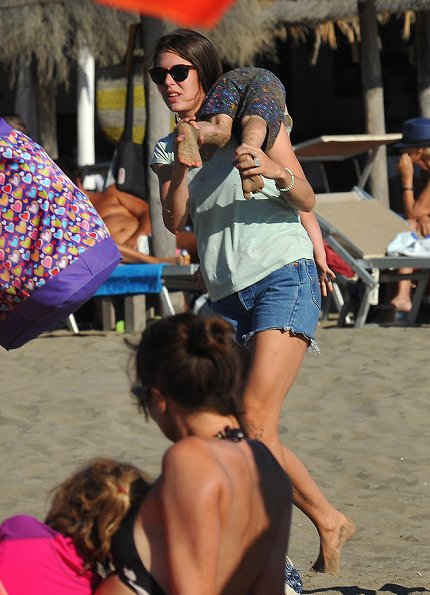 Charlotte Casiraghi and son, Raphaël Casiraghi Elmaleh on the beach in Tuscany, holiday style