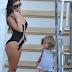 Kourtney Kardashian shows off her figure in sexy black one-piece swimsuit