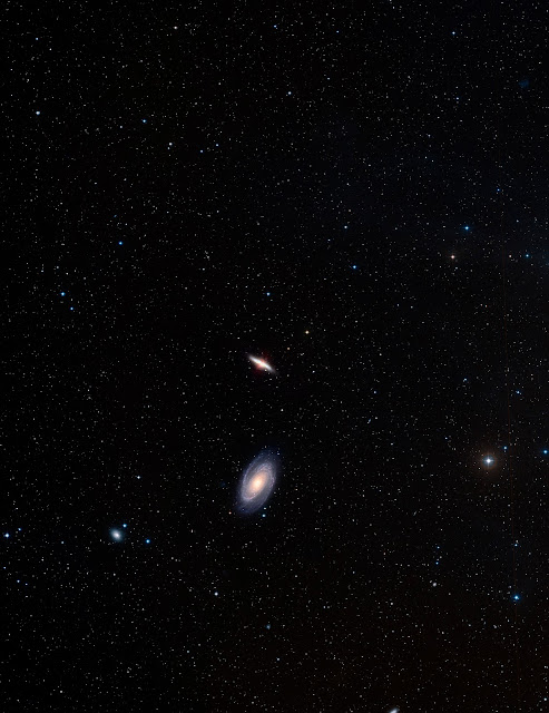 The spiral galaxy M81 and the neighbor galaxy M82 as seen in ground-based images from the Digitized Sky Survey 2 (DSS2). The image is a colour composite from DSS2 images. The field of view is 2.8 degrees
