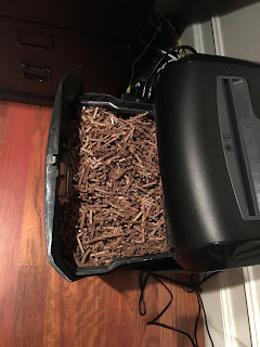Photo of cardboard shreds in the hopper of a paper shredder. https://trimazing.com/