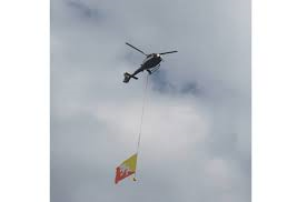 Photo of helicopter carrying Bhutan's national flag. Image courtesy: HB Rai's Facebook timeline