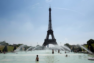 People trying to cool down in the Trocadero Fountain in front of the Eiffel Tower in Paris. (Credit: Ludovic Marin/Agence France-Presse — Getty Images) Click to Enlarge.