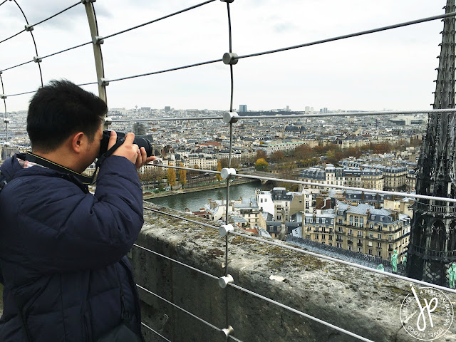 man taking photos of city