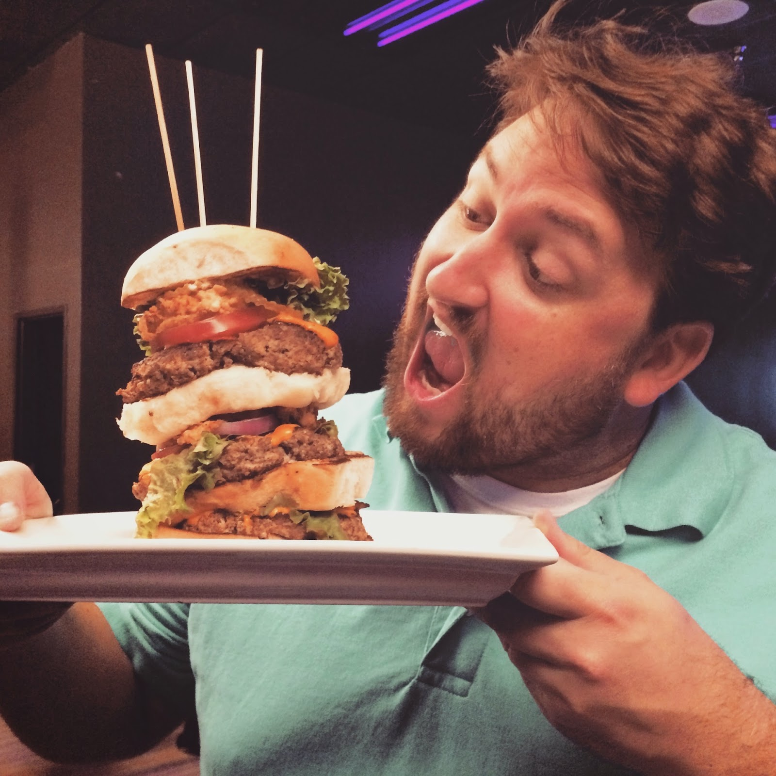 Jay Ducote gets a good look at the Triple Quarters Burger