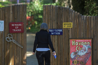 A visitor approaches the gates to the driveway leading to the home of actress and author Carrie Fisher, best known for playing the role of Princess Leia in 'Star Wars', who passed away in Los Angeles, California, on December 27, 2016