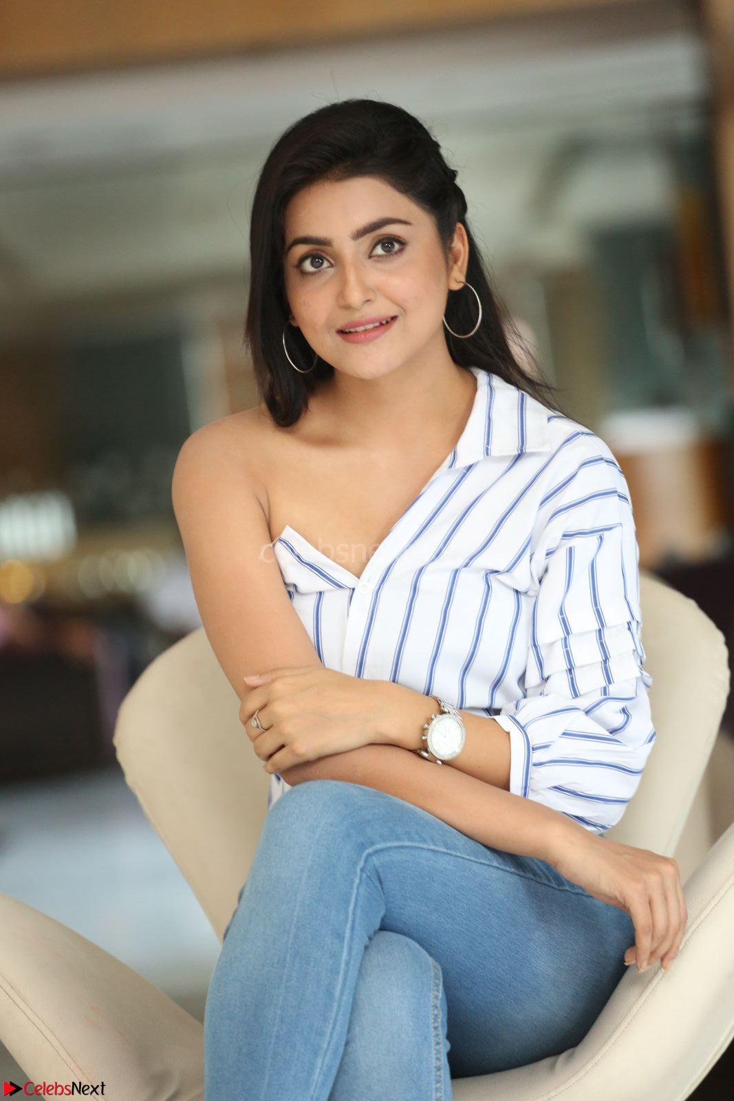Avanthika Mishra in One Shoulder Crop Top and Denim Jeggings at At Vaishakham Movie Press Meet ~ CelebsNext Exclusive
