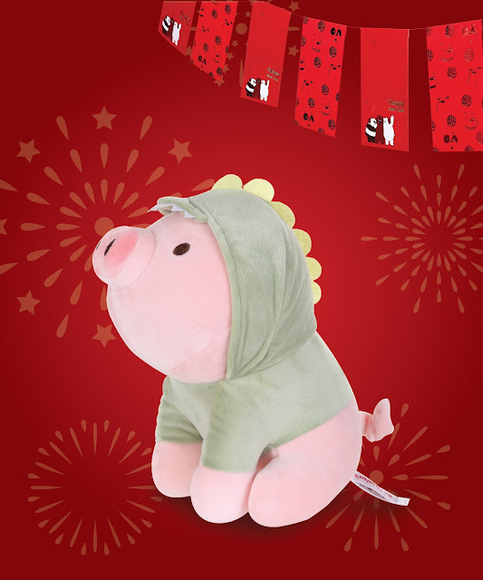 Keep a positive vibe around you with this endearing pig plush toy in dinosaur costume.