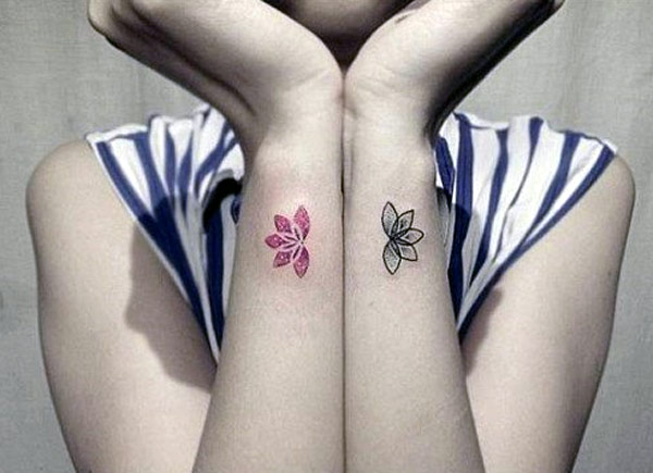 the small tattoos lotus designs really nicely for girl wrists