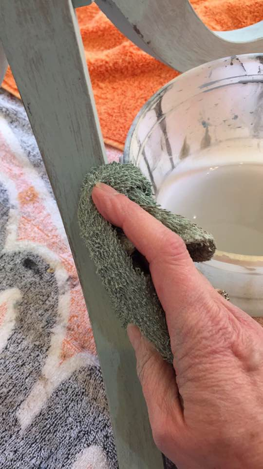 Use a damp washcloth to wet distress the paint.