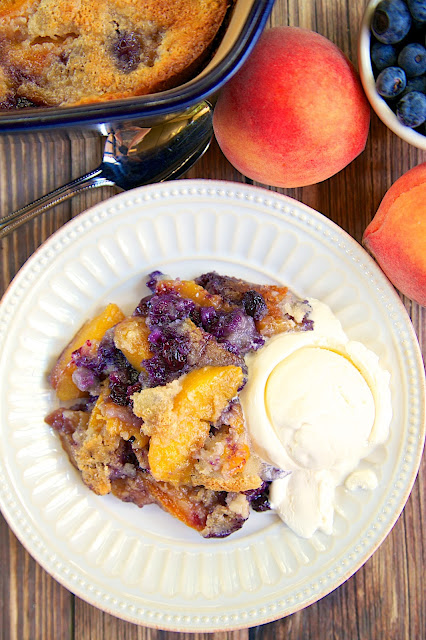 Country Blues Peach Cobbler - peaches, blueberries, butter, Martha White Blueberry Muffin mix - super quick and easy dessert - can use fresh or frozen peaches and blueberries. Serve with ice cream for a delicious dessert!