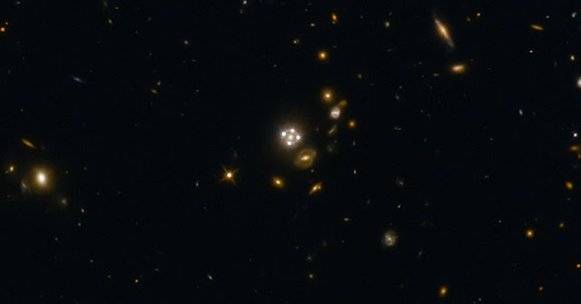 HE0435-1223, located in the centre of this wide-field image, is among the five best lensed quasars discovered to date. The foreground galaxy creates four almost evenly distributed images of the distant quasar around it.  Credit: ESA/Hubble, NASA, Suyu et al.