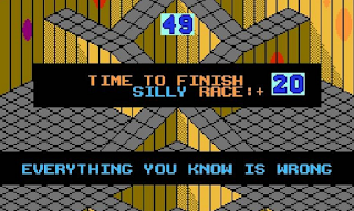 "Screenshot of Marble Madness Silly Race level with text ""Everything you know is wrong""."
