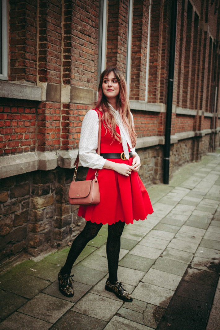 Outfit: red pinafore, white pussybow blouse, gucci belt, studded oxfords