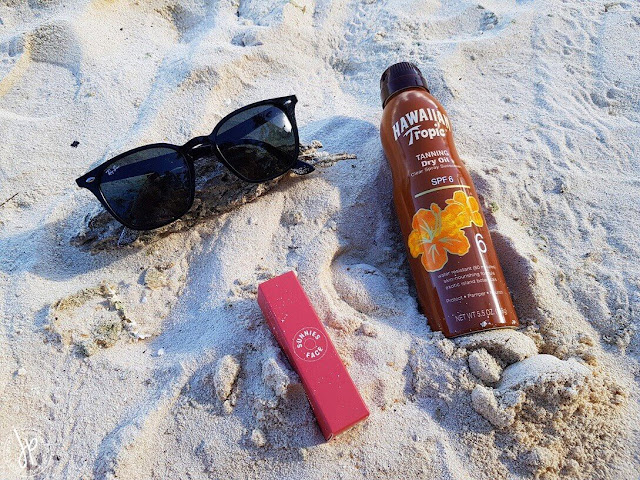 ray ban, lipstick, tanning oil spray