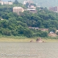 I never visited Govind Sagar lake near Bilaspur till I was invited for a religious ritual by one my relatives. I found that lot of boats can be seen around the shoreline, which are used to commute on daily basis. It seems that, there are few steam boats which can be used to commute towards Bhakhra Dam  During this visit, I also got to know that few temples get submerged into the water of Govind Sagar Lake. And most of these can be seen during summers, when water level is low. I found this place quite interesting but at the same time it can be very hot in summers.   I have never heard about Bilaspur in past but when I visited, I thought of sharing because lot of viewers of this blog like doing ad-hoc road journeys and don't follow the typical check-lists shared all over the web. Such experiences are worth mentioning for true travellers who make plans on the go. I would be more than happy if you have more questions about Bilaspur or Govind Sagar Lake in Himachal Pradesh.