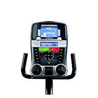 2013 Schwinn 270's console, image, with Dual Track blue backlit LCD display, 29 programs, 25 resistance levels, 4 user profiles, speakers with MP3 input, USB port, cooling fan