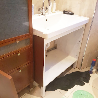 what claire did ikea hack bathroom remodel during priming