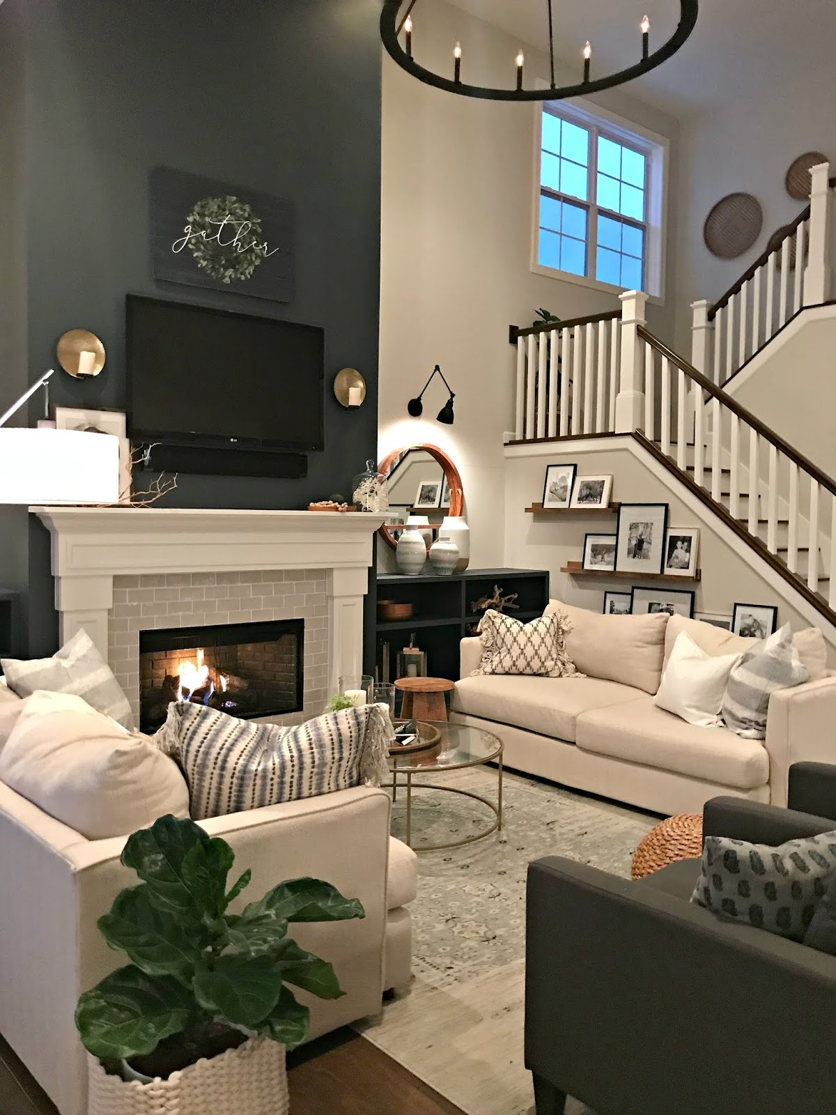 Tall fireplace and open stairs in family room