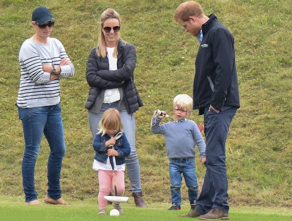 Mint Velvet Navy & Grey Stripe Zip Back Knit. Mia Tindall attends the Maserati Royal Charity Polo Trophy