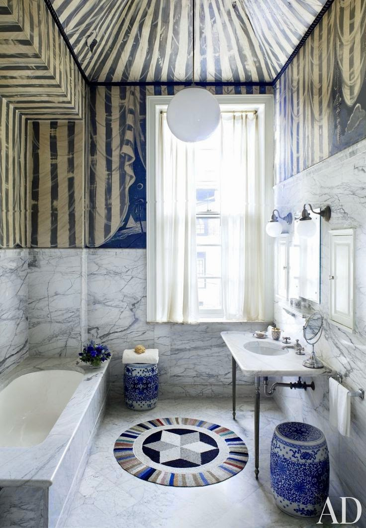 veined marble bathroom via belle vivir blog, heavily veined marble bathroom with painted tent half wall up