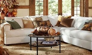 Well staged neutral color living room.