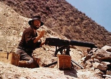 Rod Steiger as the Mexican bandit Juan Miranda in Duck, You Sucker!, loading a machine gun, getting ready to fire, Directed by Sergio Leone