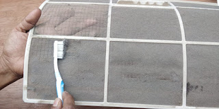 cleaning air filter using brush