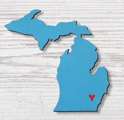 blue magnet shaped like the state of Michigan, with a heart where Ann Arbor would be
