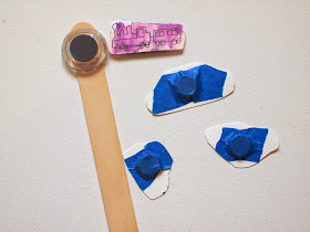 tape your magnets onto your popsicle stick and the back of your pieces