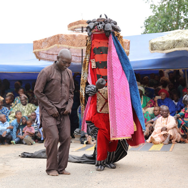 the guardian of the Egungun dancing at the palace of the Oba in Osogbo