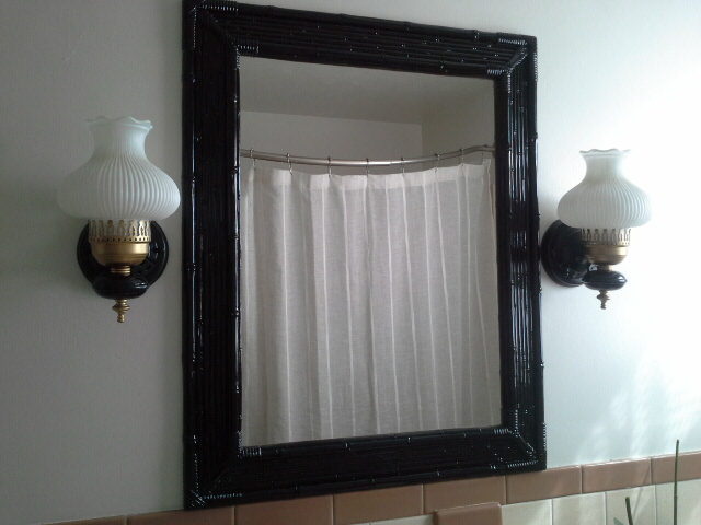 Vintage Bathroom Makeover black bamboo mirror gold and black light fixture
