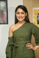 Pragya Jaiswal in a single Sleeves Off Shoulder Green Top Black Leggings promoting JJN Movie at Radio City 10.08.2017 093.JPG